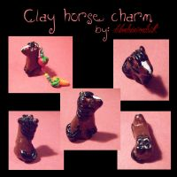 Clay horse charm by BloodStainedSilk