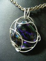 Dichroic glass in simple wire wrapping by BacktoEarthCreations