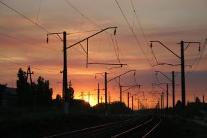 Sunset on a railroad stock #5 by croicroga