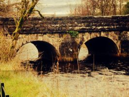 old bridge over river by awhitethorn