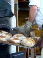 Baker man is baking bread by Tricia-Danby