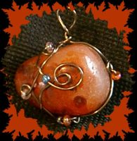 Fire stone pendant by The-Fattness