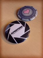 Aperture Labs and Companion Cube Buttons by Monostache