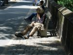 Homeless on bench in New York by wipeout