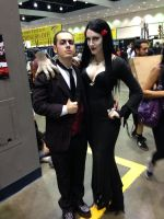 Gomez and Morticia Addams with Thing by The-1One