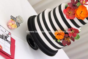 black and white stripy cake with flowers by zoesfancycakes