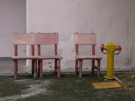 Three chairs and a fire hydran by iskandar63