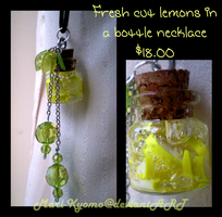 Fresh cut lemons in a bottle necklace - sold by Mari-Kyomo