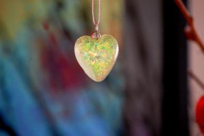 Shimmering heart necklace by OcularFracture
