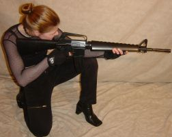 Jodi Crouched Aiming Her Rifle by FantasyStock