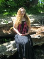 Grace in the woods by SolStock