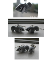 Anteater earrings by Tirrih