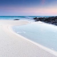 Bleached sand and ocean vapour by peterpateman