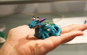Tiny Crackle the dragon by Archaleo