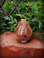 VIKING KNIT Round Bottle Filled with Amber Beads 1 by thewellandspindle