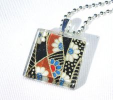 Black brown blue glass pendant by inchworm