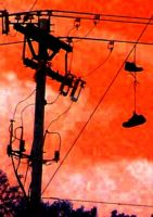 Shoes on a powerline by RedBlackThorn