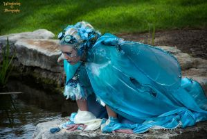 Water fairy kneeling over the pond by AzreGreis