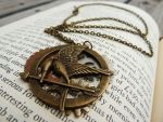 Gears and Mockingjay Necklace by CheleKat