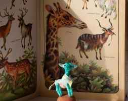 Turquoise giraffe by freedragonfly