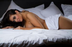 Jessica on white sheets by wphotography