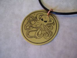 etched brass octopus pendant by creativeetching