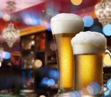Beer Glass and Mug with Foam on Bar Scene by ProPhotoStock
