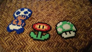 Mushroom, Fire Flower, and Toad pixle by jaybird28
