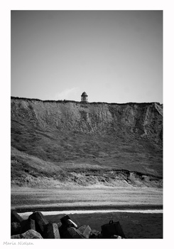 Lighthouse peeking over the cliff by Moonbird9