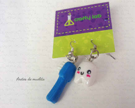 Little Tooth and toothbrush earrings by PetiteTangerine