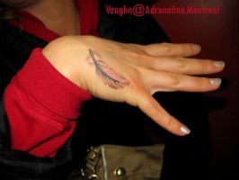 Feather on hand by supernaturaltattoo